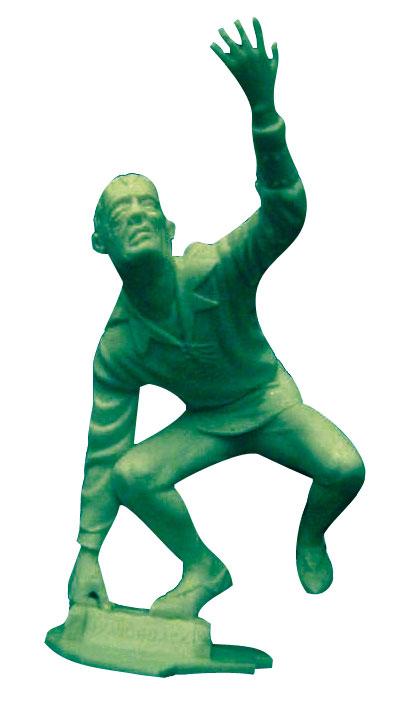 plastic hunchback figure